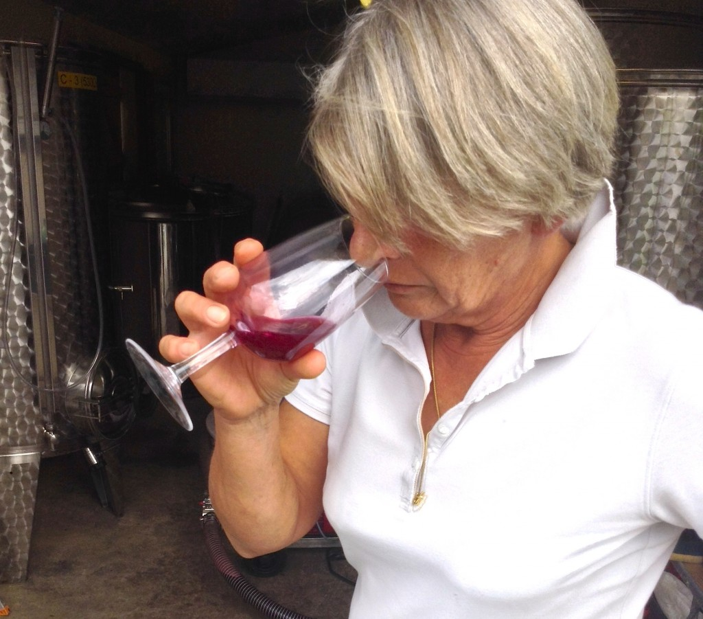 Happy Vigneronne - Pascale tastes the fermenting juice back in October 2013.