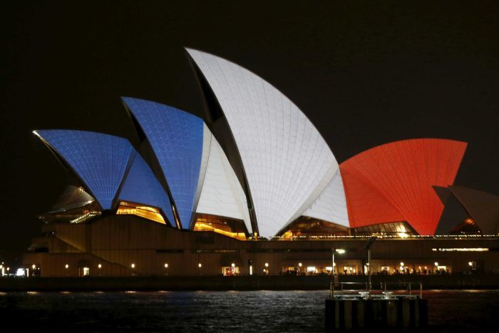 Sydney Opera House goes French in support for a nation and world that mourns. Photo Reuters: Jason Reed