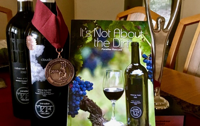 Paradise Rescued book, medal winning wine and international business award.
