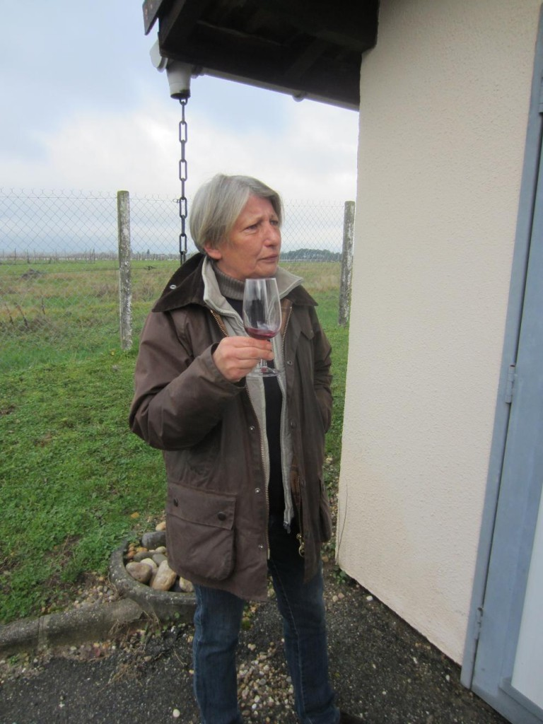 Good reason to smile - our vigneronne Pascale tastes the first CabMerlot